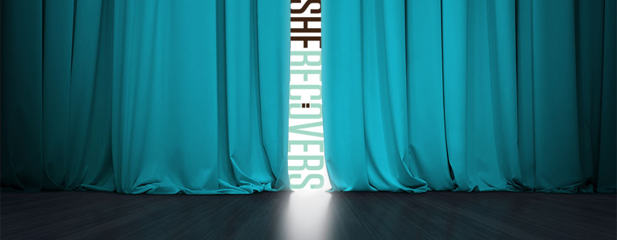 teal velvet curtain with she recovers logo peeking through